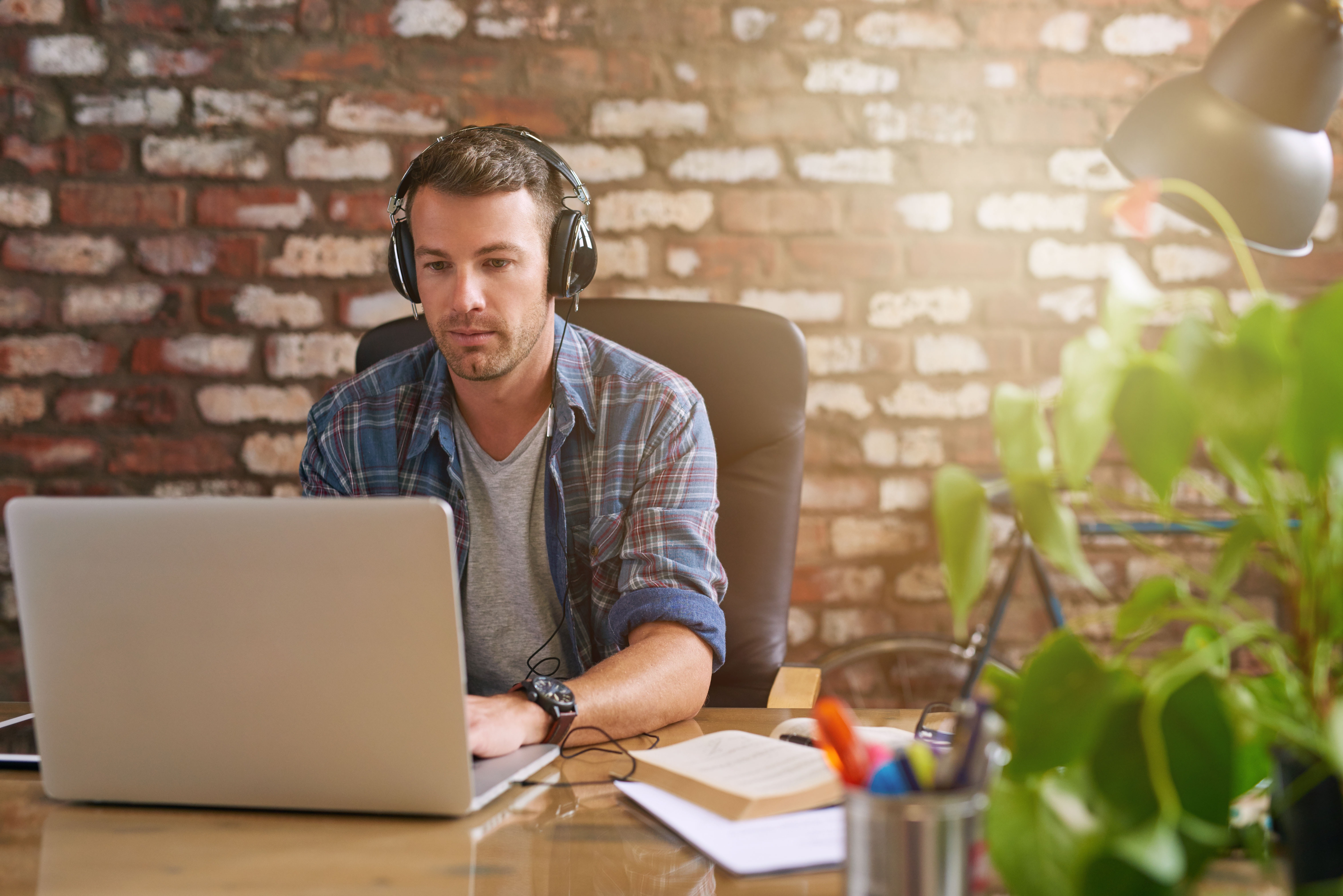 Man listening to top tech podcast